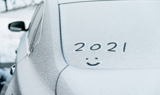 New year 2021 written on car windshield stock photo