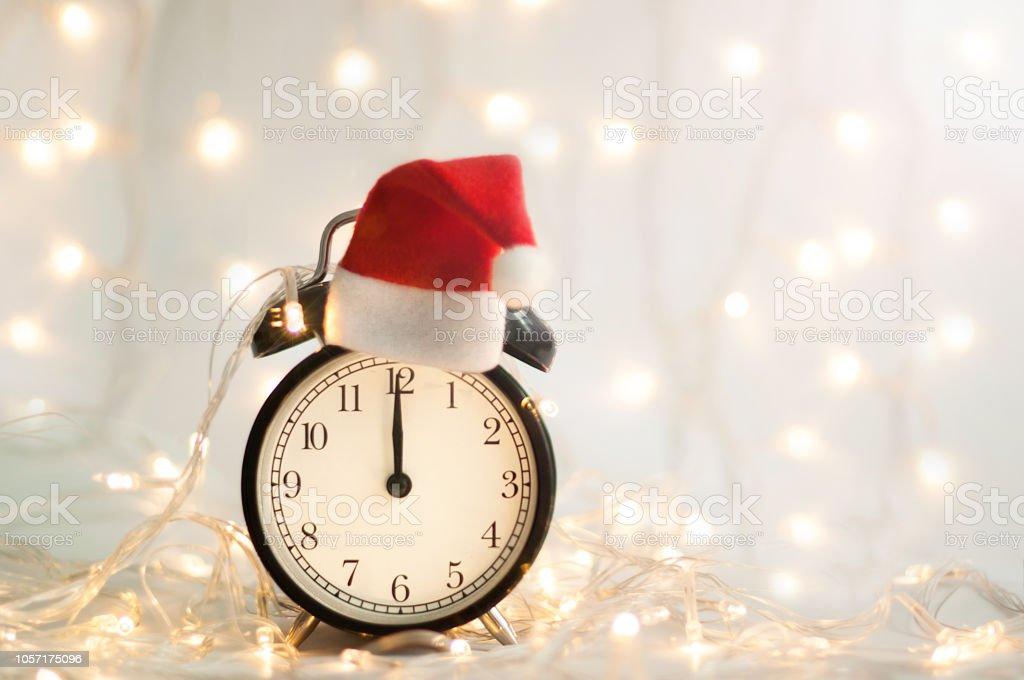 New Year alarm clock. Midnight. Festive Chritmas background.