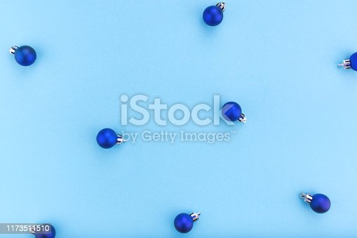 istock New year and Christmas concept. Christmas balls on blue background. 1173511510