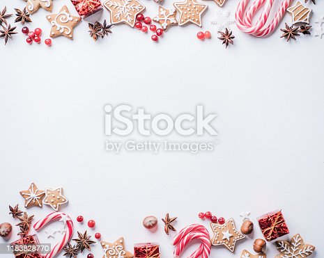 Christmas composition, New Year greeting card. Mockup with festive food decorations and gingerbread cookies on white background. Copy space