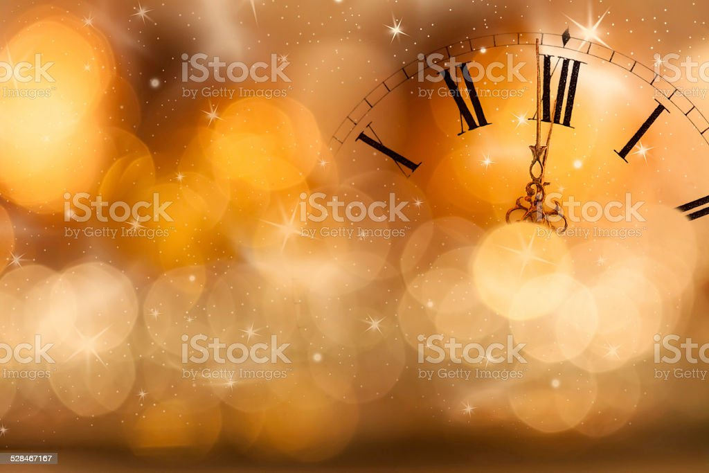 New Year at midnight: Old clock and holiday lights stock photo