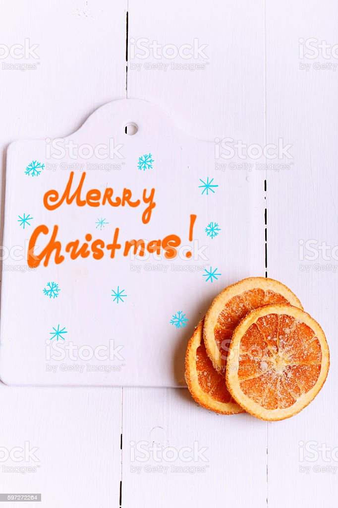 New Year background cutting board with the words Merry Christmas royalty-free stock photo