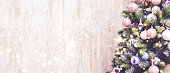 istock New Year banner with Christmas tree and holiday lights. 1166773519
