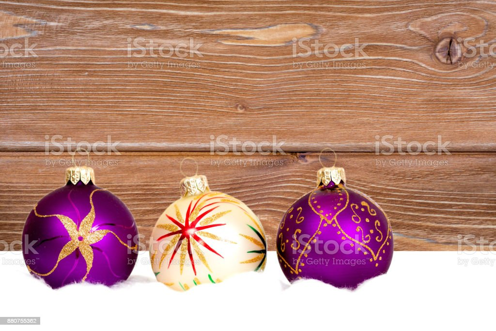 new year baubles on wooden background stock photo
