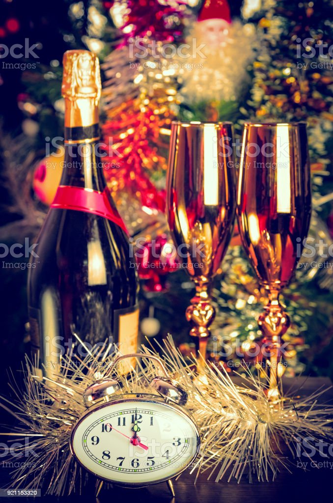 new year bottle of champagne glasses stock photo