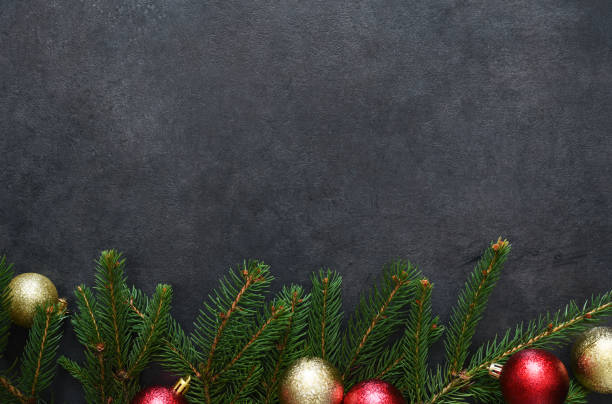 new year card. christmas diction with fir and balls on a black background. - diction stock pictures, royalty-free photos & images