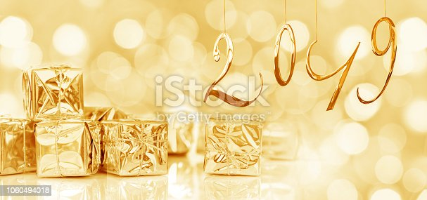 1080262636 istock photo 2019 new year card, Small Christmas gifts in shiny golden paper, bokeh lights background 1060494018
