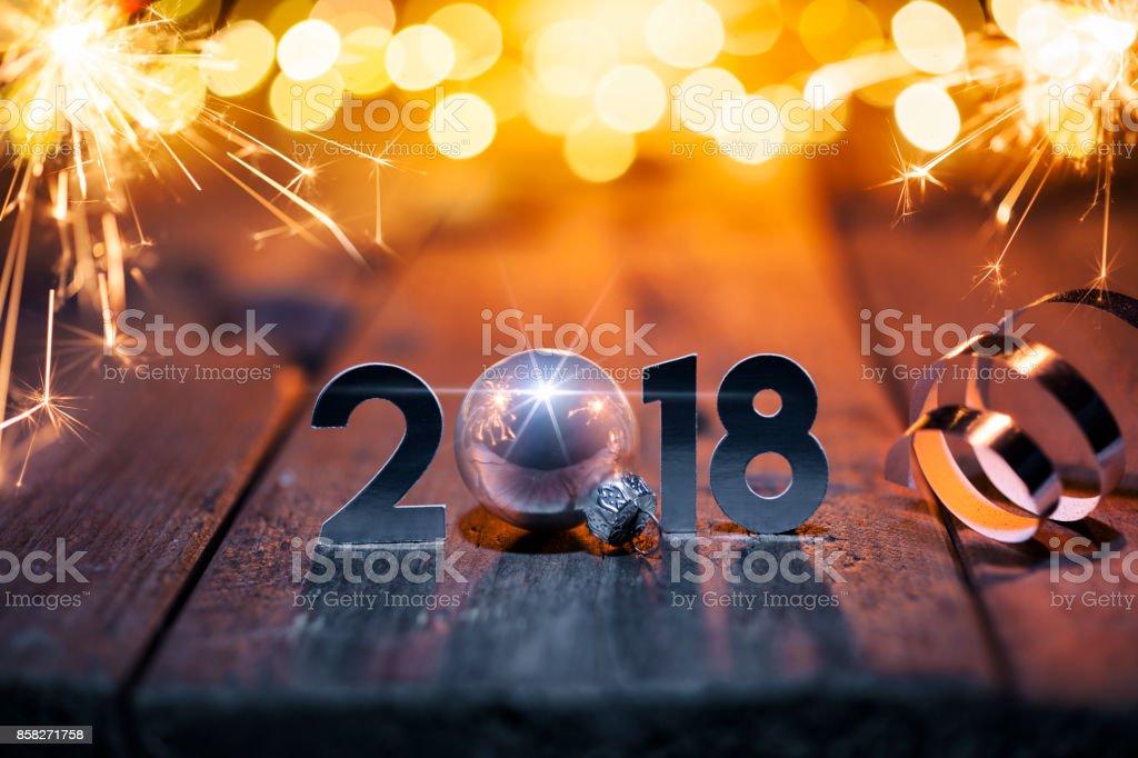 New Year Celebration 2018 - Christmas Sparkler Lights Wood stock photo
