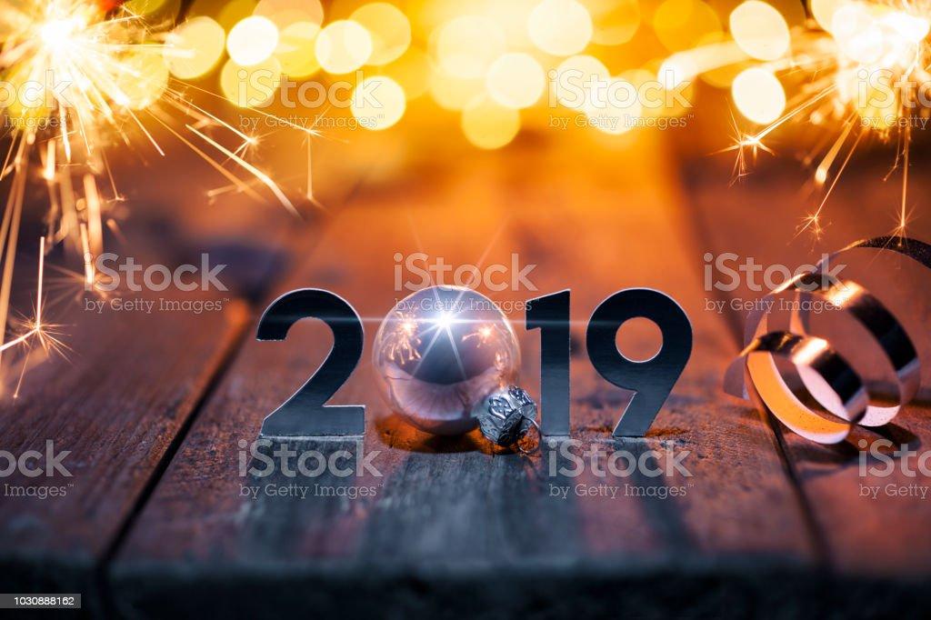 New Year Celebration 2019 - Christmas Sparkler Lights Wood defocused stock photo
