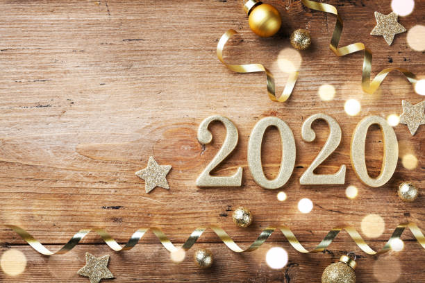 new year celebration and festive background with golden numbers 2020, confetti stars and christmas decorations top view. - new years day stock pictures, royalty-free photos & images