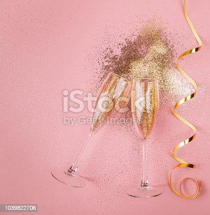 1040055260istockphoto New year celebration concept on pink background 1039822706