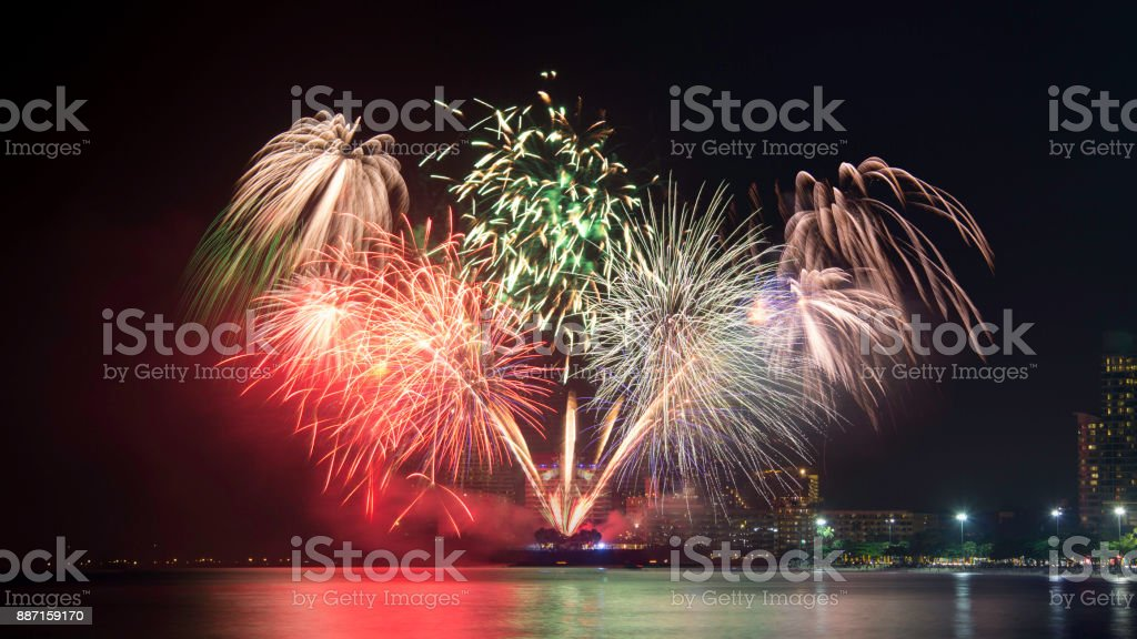New Year celebration fireworks. Brightly Colorful Fireworks isolated black background. stock photo