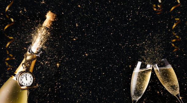 New year celebration party with champagne bottle and glasses toasting stock photo