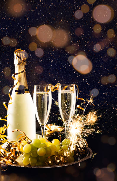 New year celebration with grapes and champagne stock photo