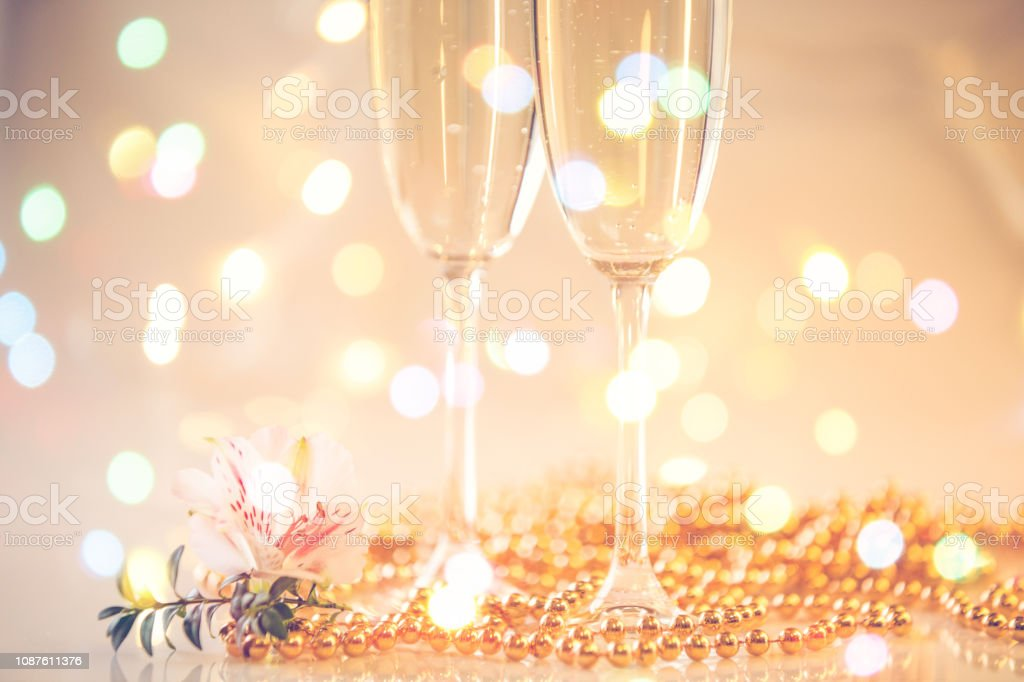 New Year Champagne glasses and fireworks background stock photo
