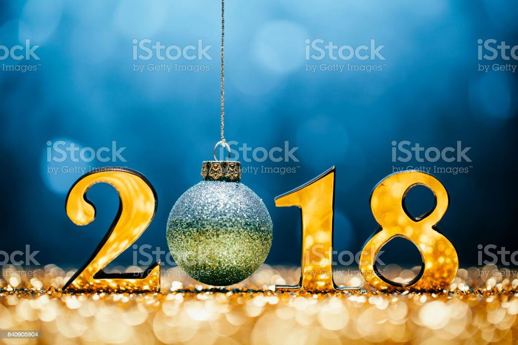 Golden numbers 2018 and christmas decorations on glitter and...