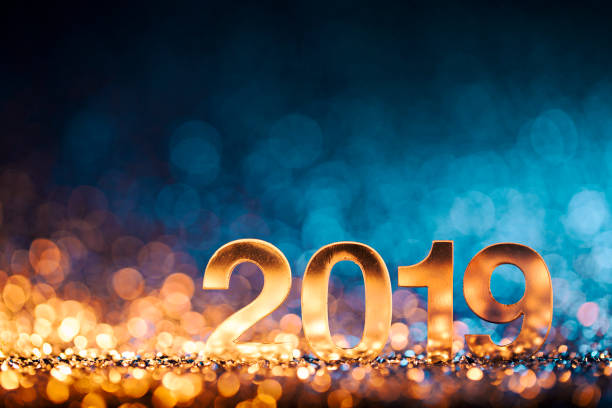 New Year Christmas Decoration 2019 - Gold Blue Party Celebration Golden numbers 2019 and Christmas decorations on glitter and defocused lights. 2019 stock pictures, royalty-free photos & images