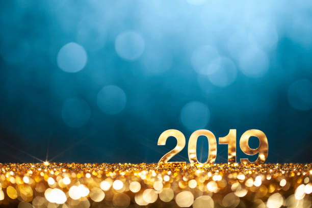 New Year Christmas Decoration 2019 - Gold Blue Party Celebration Golden numbers 2019 and defocused lights. 2019 stock pictures, royalty-free photos & images