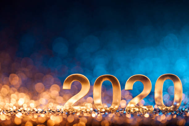 New Year Christmas Decoration 2020 - Gold Blue Party Celebration Golden numbers 2020 and Christmas decorations on glitter and defocused lights. new year's eve stock pictures, royalty-free photos & images
