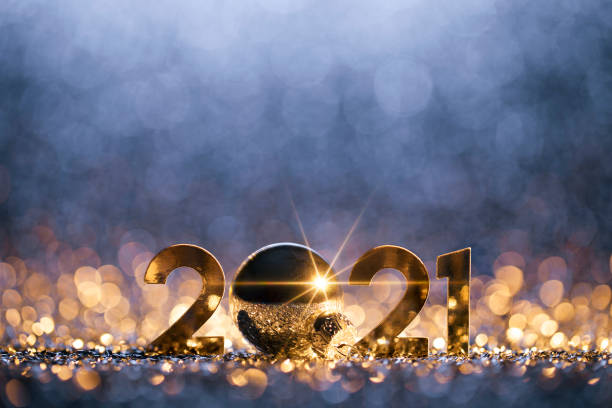 New Year Christmas Decoration 2021 - Gold Blue Party Celebration Golden numbers 2021 and Christmas decorations on glitter and defocused lights. happy new year 2021 stock pictures, royalty-free photos & images