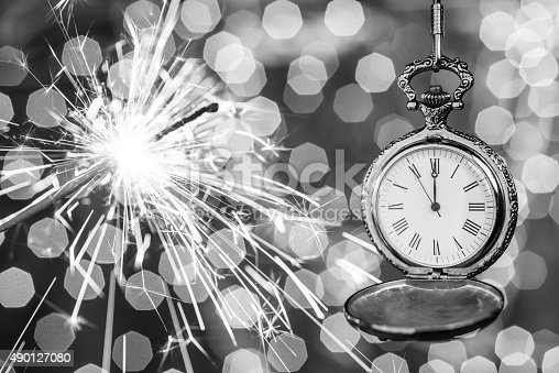 istock New year clock counting down and sparkler 490127080