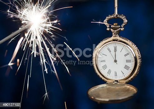 istock New year clock counting down and sparkler 490127102