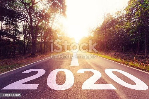 1170070487 istock photo New Year Concept : Empty asphalt road sunset and New Year 2020. 1159390905