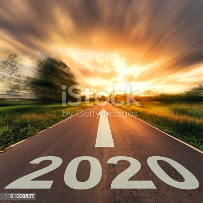 1170070487 istock photo New Year Concept : Empty asphalt road sunset and New Year 2020. 1161009537