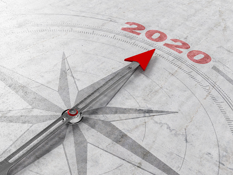 istock 2020 New Year Concept with Arrow of A Compass Pointing 2020 1183405643