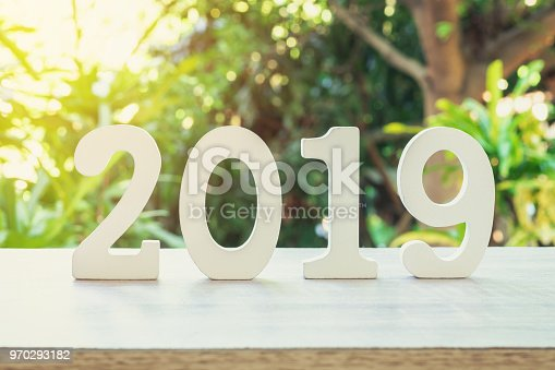 1009979852 istock photo New year concept : wooden number 2019 for new year on wood table with sunlight. 970293182