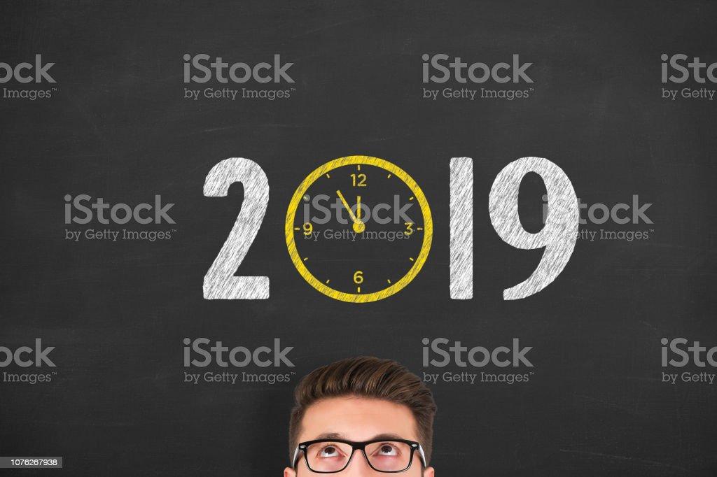 New year concepts 2019 countdown clock on human head on chalkboard