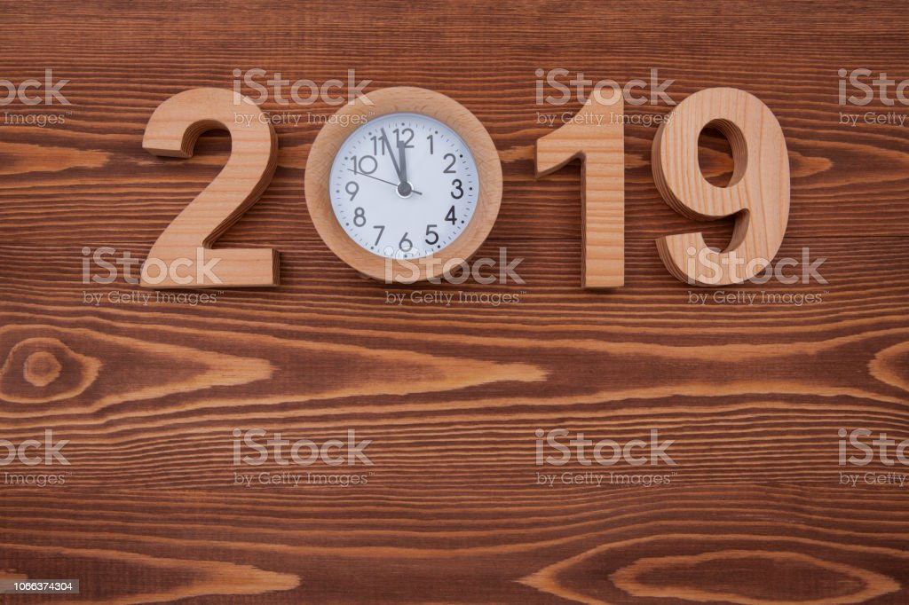 New year concepts 2019 countdown clock on woden table