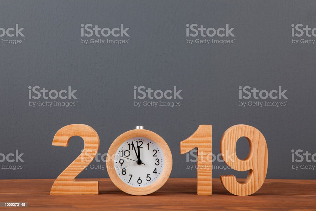 New year concepts 2019 countdown clock on wood