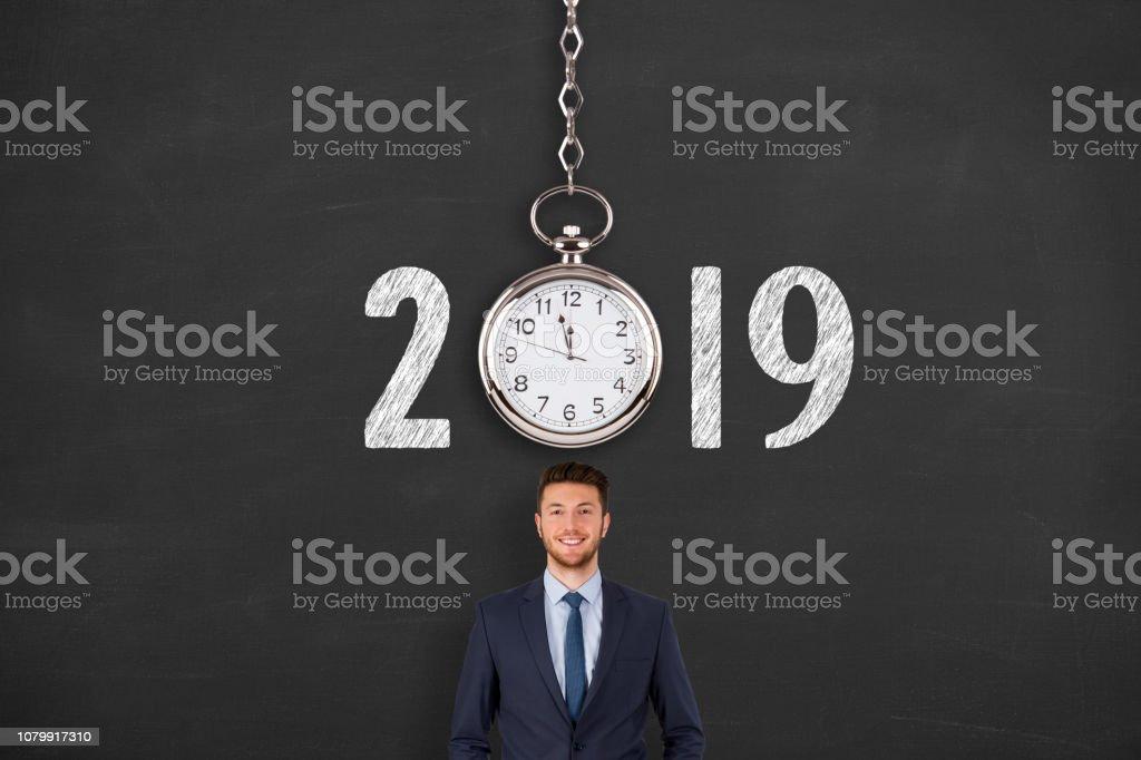 New year concepts 2019 countdown clock over human head on blackboard