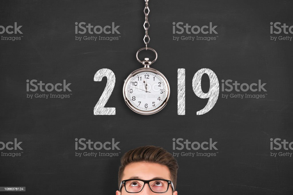 New year concepts 2019 countdown clock over human head on chalkboard