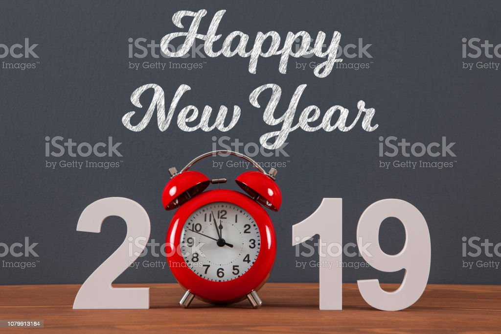 New year concepts 2019 countdown clock with red clock on wooden table
