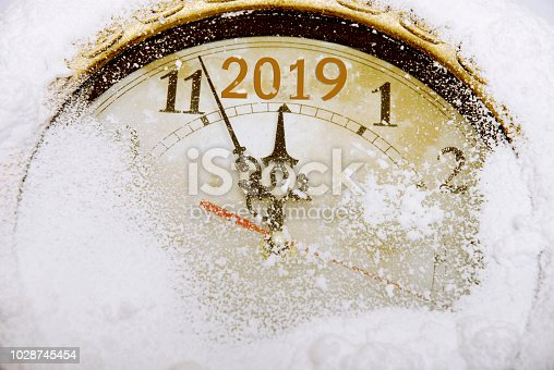 New year countdown on a wall clock