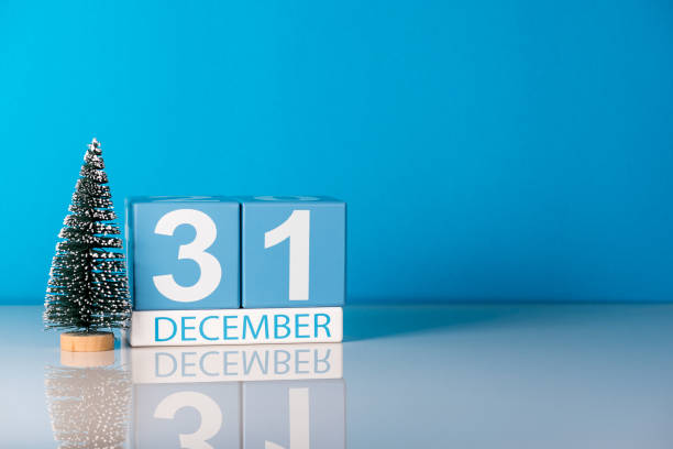 New year. December 31st. Day 31 of december month, calendar with little christmas tree on blue background. Winter time. Empty space for text. New year concept stock photo