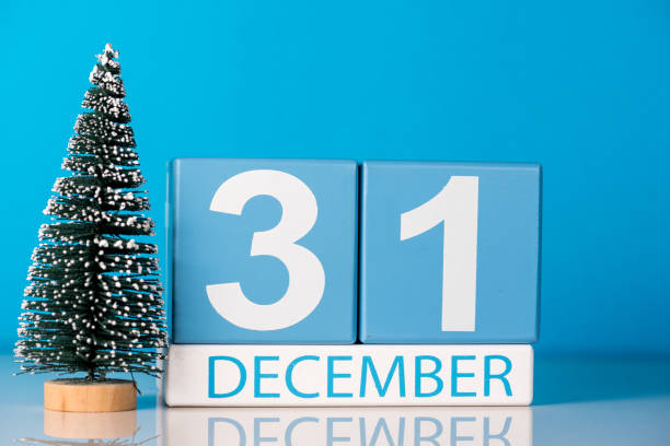 New year. December 31st. Day 31 of december month, calendar with little christmas tree on blue background. Winter time. New year concept stock photo