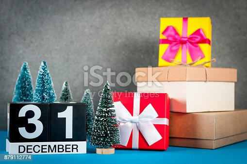 istock New year. December 31st. Image 31 day of december month, calendar at christmas and new year background with gifts and little Christmas tree 879112774