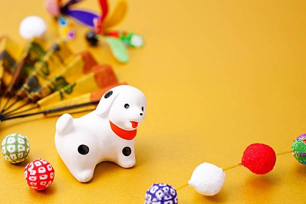 New Year decorations and dog zodiac figurine - Photo