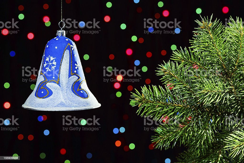 New Year decorations bell on dark multicolor circles bokeh royalty-free stock photo