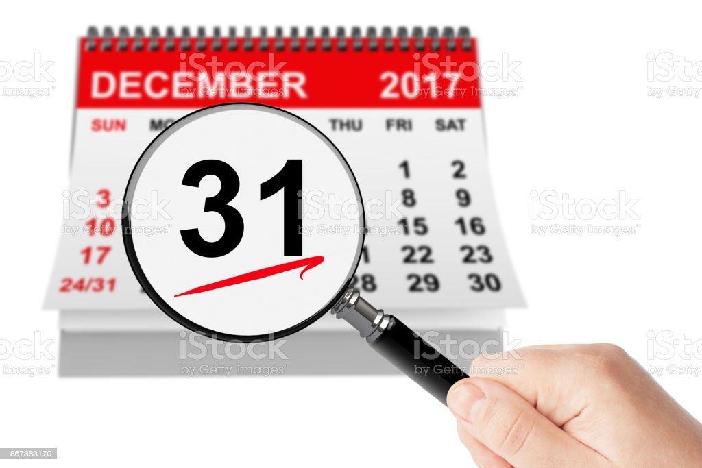 New Year Eve Concept. 31 December 2017 calendar with magnifier stock photo