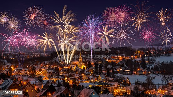 New year eve firework and Illuminated houses in Seiffen at Christmastime. Saxony Germany.