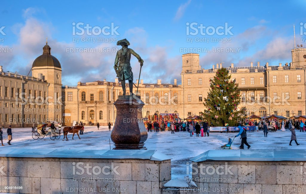 New Year Fair on the parade ground in front of the Gatchina Palace. In the foreground is a monument to Emperor Paul 1. stock photo