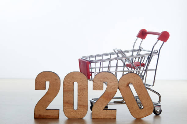 Cтоковое фото New year festival shopping concept, New year and Christmas with shopping cart With the letter 2020 on wood