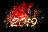New year fireworks and 2019 written in sparkling letters