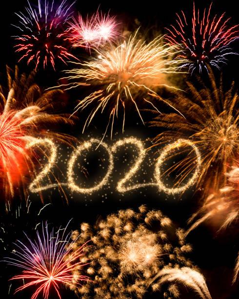 2020 New Year fireworks background stock photo