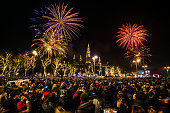 many people celebrating turn of the year with fireworks in Vienna