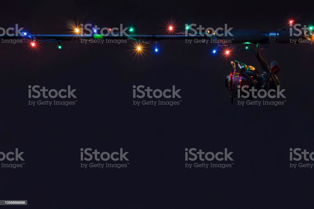 New year fishing concept. Holiday garland with tackles stock photo